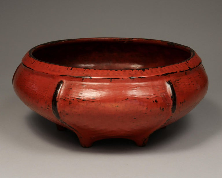 Burmese woven bamboo and red lacquered offering bowl, early 20th century  This lovely offering bowl features six distinctive black ribs and six feet on black bottom. Note artist's signature. Woven bamboo is lacquered in layers - first black, then