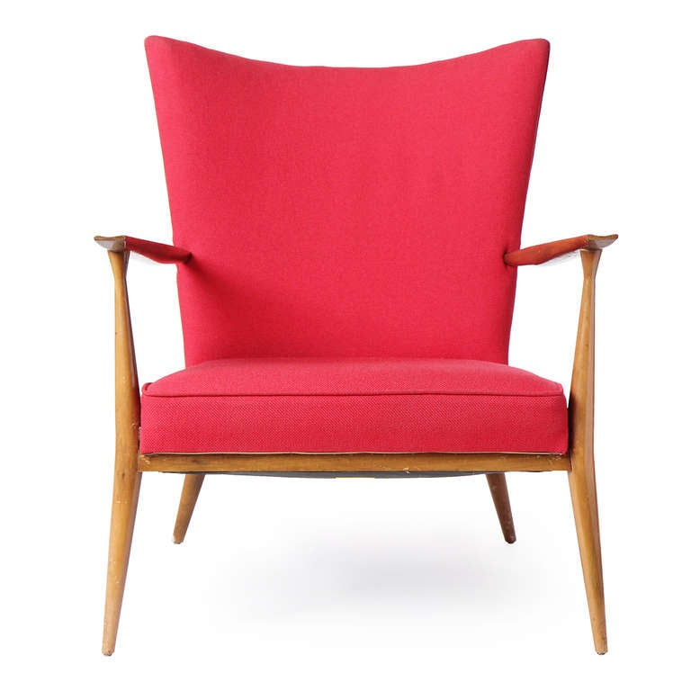 An excellent Mid-Century Modern lounge chair designed by Paul McCobb featuring a vibrant red wool upholstery supported by sculpted sinuous arms and legs. Crafted in the USA, circa 1960s.