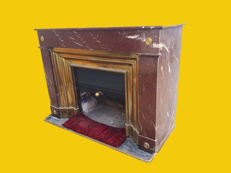 A most unusual and rare red and cream flecked marble fireplace circa 1890 with brass molded inserts and a slide to cover the opening when not in use.