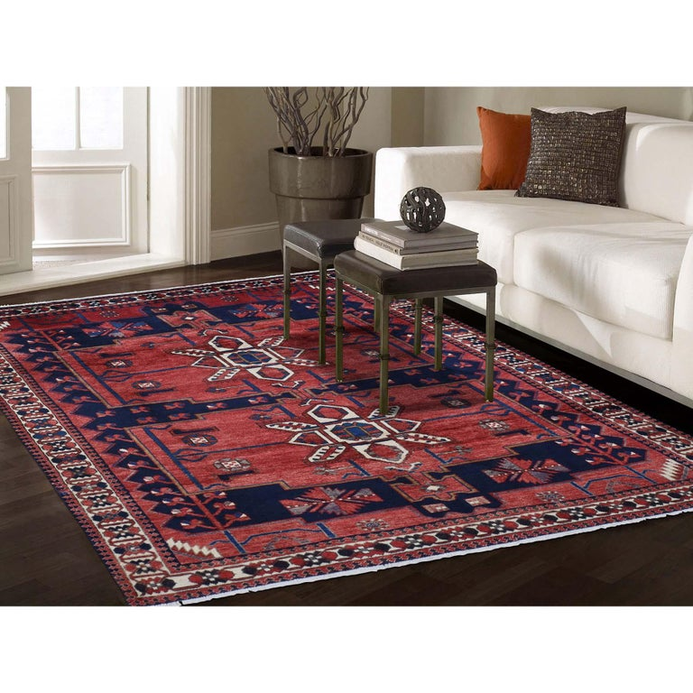 This is a truly genuine one-of-a-kind red new persian Bakhtiari pure wool hand knotted Oriental rug. It has been knotted for months and months in the centuries-old Persian weaving craftsmanship techniques by expert artisans. Measures: 6'9