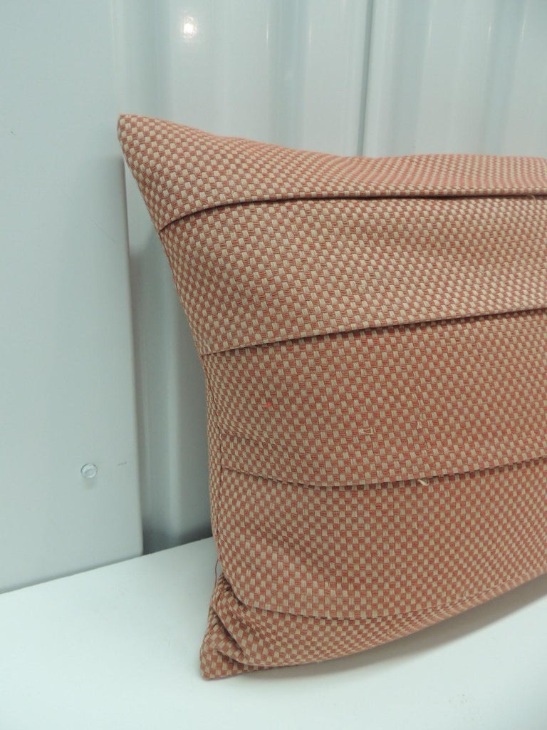 Red pleated woven silk decorative lumbar pillow. Double-sided, zipper closure. Feather/down insert. Size: 12 x 18 x 6.