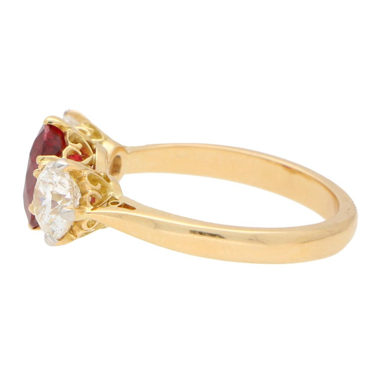 Oval Cut Red Ruby and Diamond Three-Stone Engagement Ring Set in 18 Karat Yellow Gold For Sale