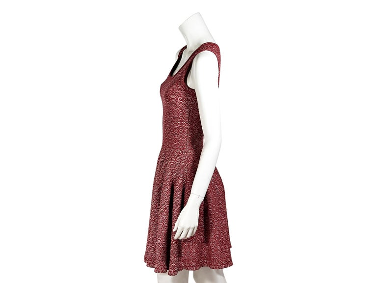 Product details:  Red and silver printed spandex fit-and-flare dress by Alaia.  Scoopneck.  Sleeveless.  Concealed back zip closure.  28