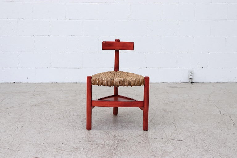 Red stained solid wood Wim, den boon style tri-pod rush chair with