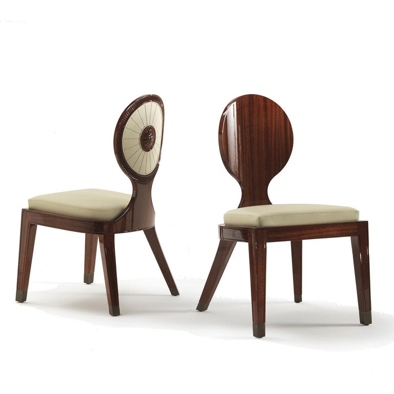 Part of the Sun collection, this dining chair is a striking addition to a modern home, where it will add an eye-catching accent thanks to its exquisite finish and a stunning back decoration in carved wood and leather inserts that evokes a stylized