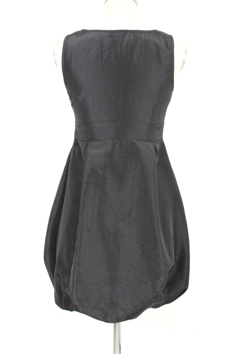 Red Valentino 2000s vintage black dress. Elegant short balloon model, with elastic and waistband. Side zip closure. Composition 100% jersey. Made in Italy. New with tag.  Size: 42 It 8 Us 10 Uk  Shoulder: 42 cm  Chest / Chest: 43 cm  Length: 86 cm