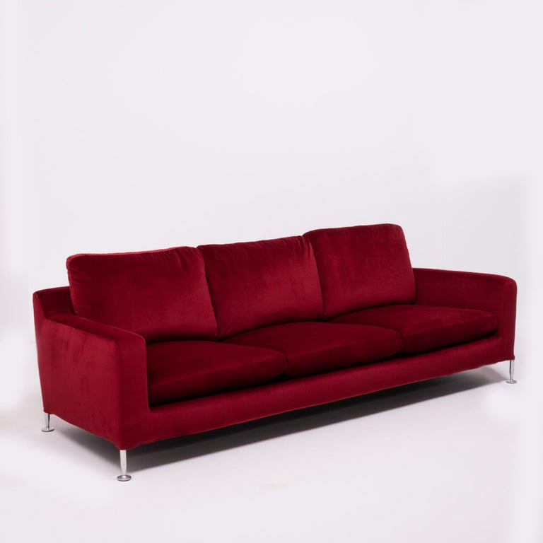 Originally designed in 1995 by Antonio Citterio for B&B Italia, the Harry sofa is named after the famous artist and furniture designer Harry Bertoia.   Newly and fully reupholstered in sumptuous crimson red velvet fabric, the three-seat sofa