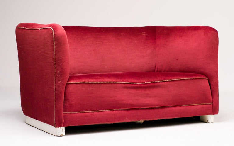 Sofa designed by Ole Wanscher for Fritz Hansen in the original red velvet. The velvet has two small repairable holes in the seat, but is otherwise in great vintage condition. The wooden base still has its original white lacquer, that has wear from