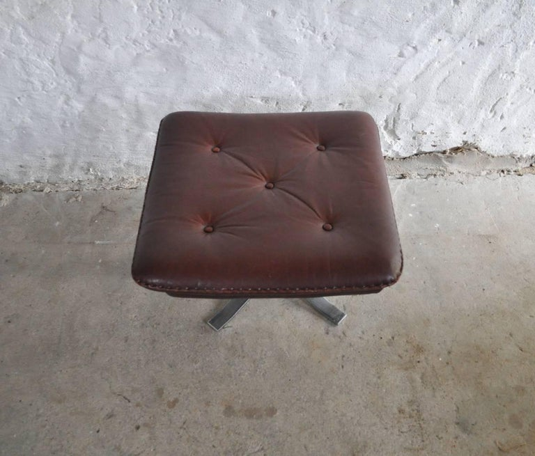 Reddish Brown Leather and Chrome Lounge Chair and Stool by Arne Norell For Sale 6