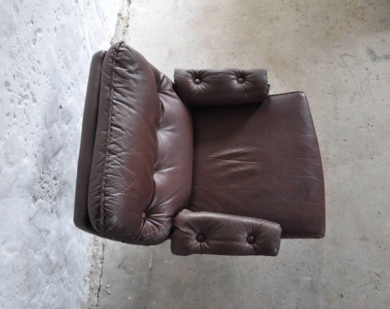 Metal Reddish Brown Leather and Chrome Lounge Chair and Stool by Arne Norell For Sale