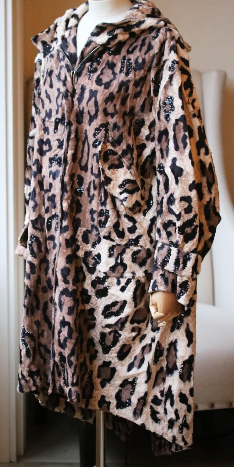 Beige and brown cotton blend parka. Leopard print parka coat from Redemption featuring a zip-up front fastening. Sequin embellishment detail all over. Two front pockets. An oversized fit. Made in Italy. 48% Cotton, 37% viscose, 15% modal. Lining: