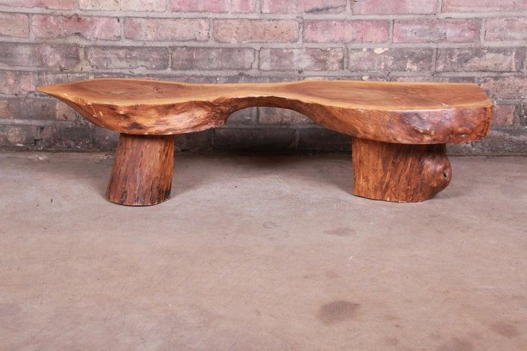 A unique handcrafted redwood rustic live edge low coffee table or occasional side table  Mid-20th century  Measures: 37