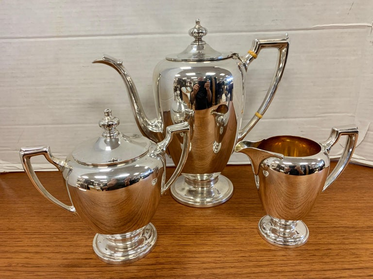 Stunning, Reed & Barton sterling silver tea set with no monograms. Three matching pieces in all. Dimensions below are for the largest piece, the coffee/tea pot. The great Gio Ponti designed some of Reed & Barton's sterling collection. These pieces