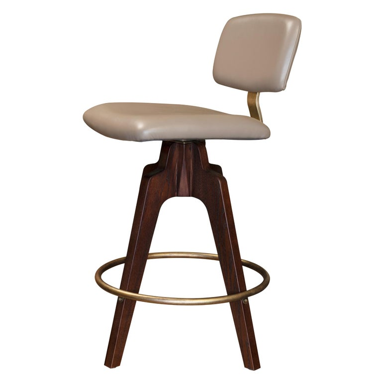 Contemporary Reeves Swivel Bar Stool with Ash legs stained Walnut, Leather and Brass Accents For Sale