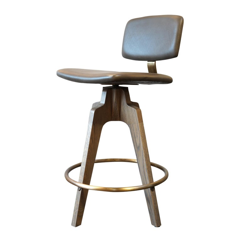 Reeves Swivel Bar Stool with Ash legs stained Walnut, Leather and Brass Accents For Sale 3