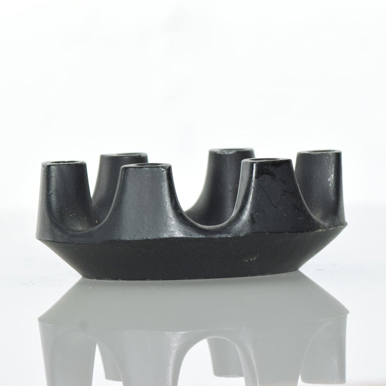 Modern refined Brutalist crown six candlestick candleholder in a sculpted iron oval ring, 1970s Measures: 3 7/8