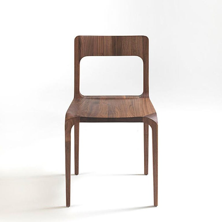 Chair refined dining in solid hand-carved walnut wood. Treated with natural oil with natural pine extracts. Also available in solid oak, cherry, maple or elm.