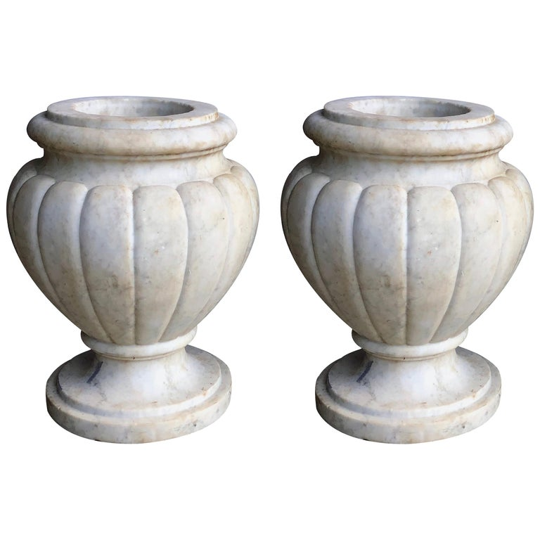 Refined Pair of Italian Neoclassical Style Carved Carrera Marble Lobed Urns For Sale