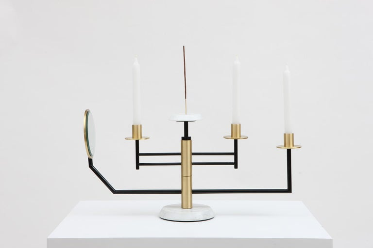 """The Reflect candelabra A candelabra that does more than just contain a flame. """"Reflect"""" creates a sensory experience which brings light to our vision, touch, and smell. Through different levels of separation and a central axis of rotation, one is"""