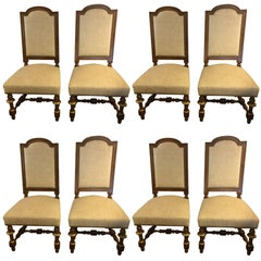 Regal Set of Eight Early French Carved Walnut and Bronze Gilded Dining Chairs