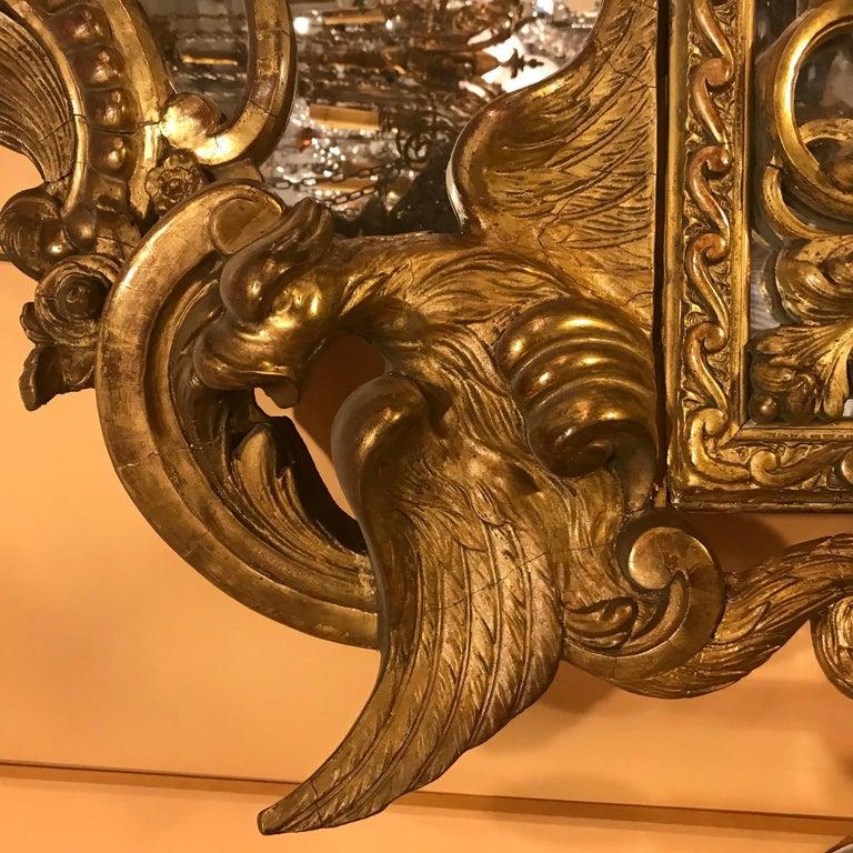 Beveled Regence Large Carved Giltwood Mirror  For Sale