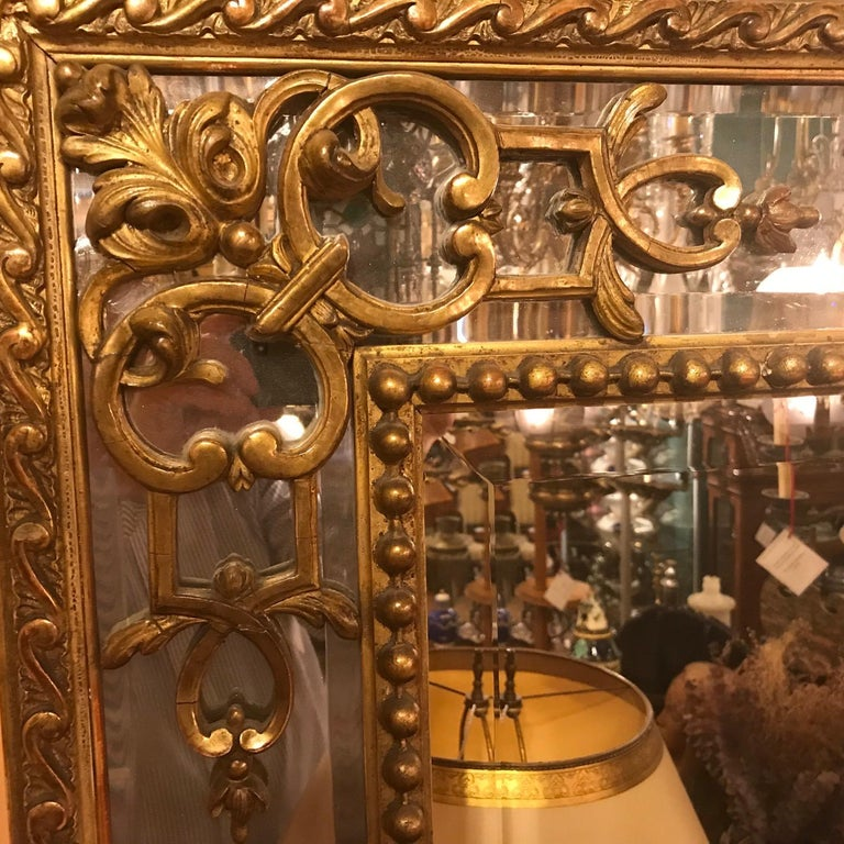 Regence Large Carved Giltwood Mirror  In Good Condition For Sale In Montreal, QC