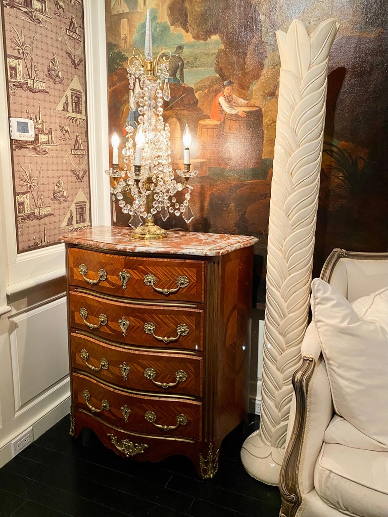 French Regence style commode or chest of drawers, marble-top, 19th century. Diamond-shape parquetry veneer, four front drawers. Carved edges, red Languedoc marble top. Gilt bronze handles and details. Smaller size makes it a great, versatile
