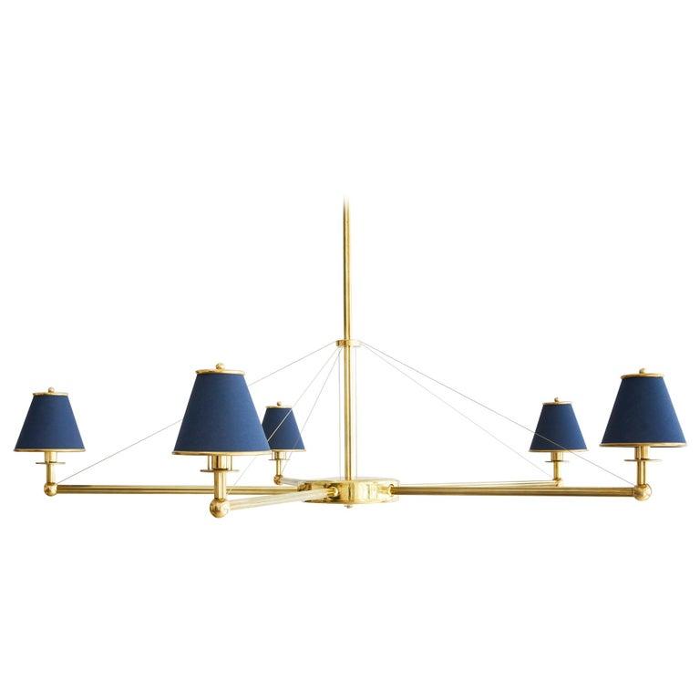 Regency five-arm chandelier in brass with navy shades