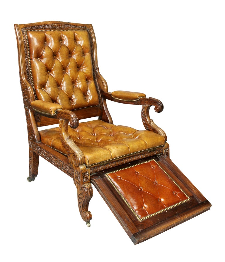With brown tufted leather back and seat set in a carved frame, raised on cabriole legs. Provenance, Harvey Antiques, London.