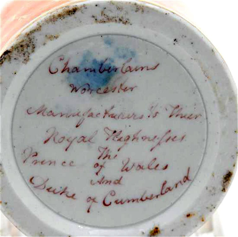 Chamberlain worcester porcelain feather-decorated inkwell, circa 1810.  The drum-shaped inkwell with a faux orange marble ground is painted on the front with a variety of bird feathers. The reverse with a marbled orange ground.  Dimensions: 2 1/2