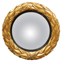 Regency English Giltwood and Ebonized Convex Laurel Leaf Bulls Eye Mirror