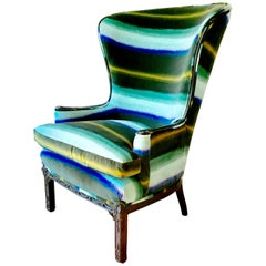 Regency Inspired Wingback Chair with Buttoned Upholstery