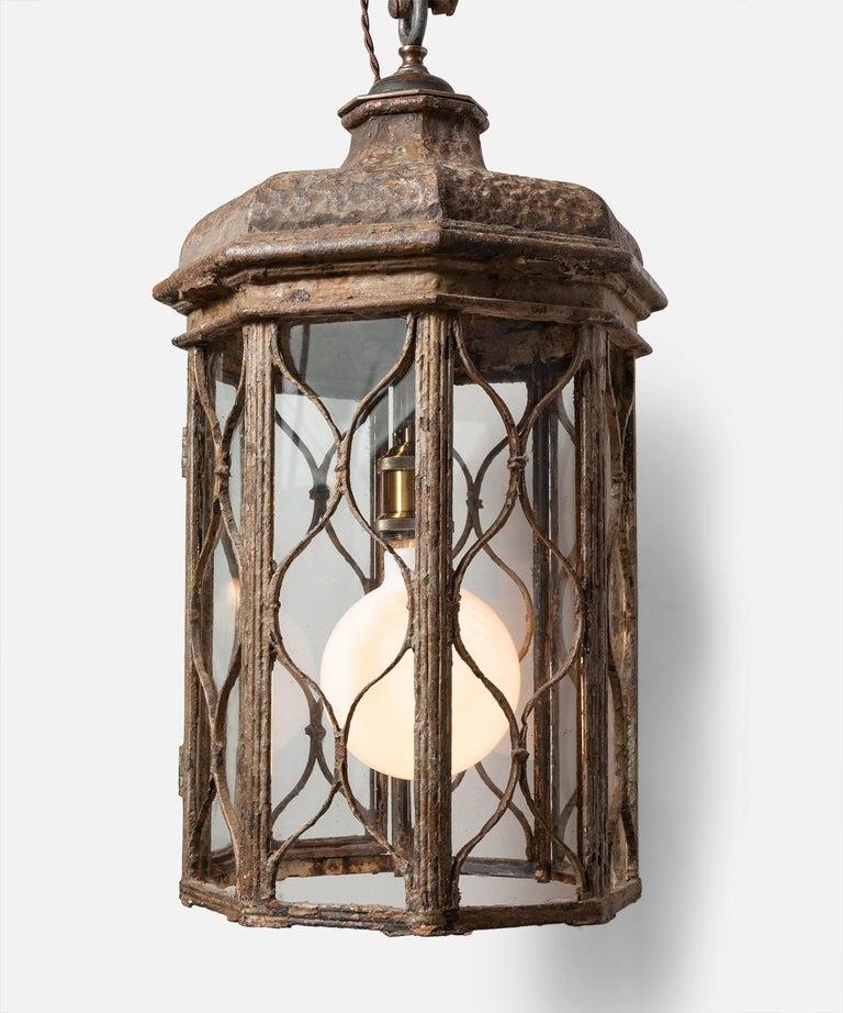 Regency iron lantern, England, circa 1815.  Octagonal form with iron work panels and clear glazing.