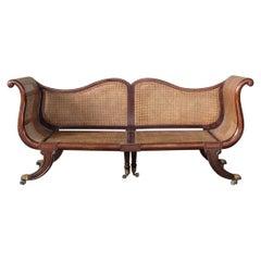 Regency Mahogany and Caned Campaign Sofa