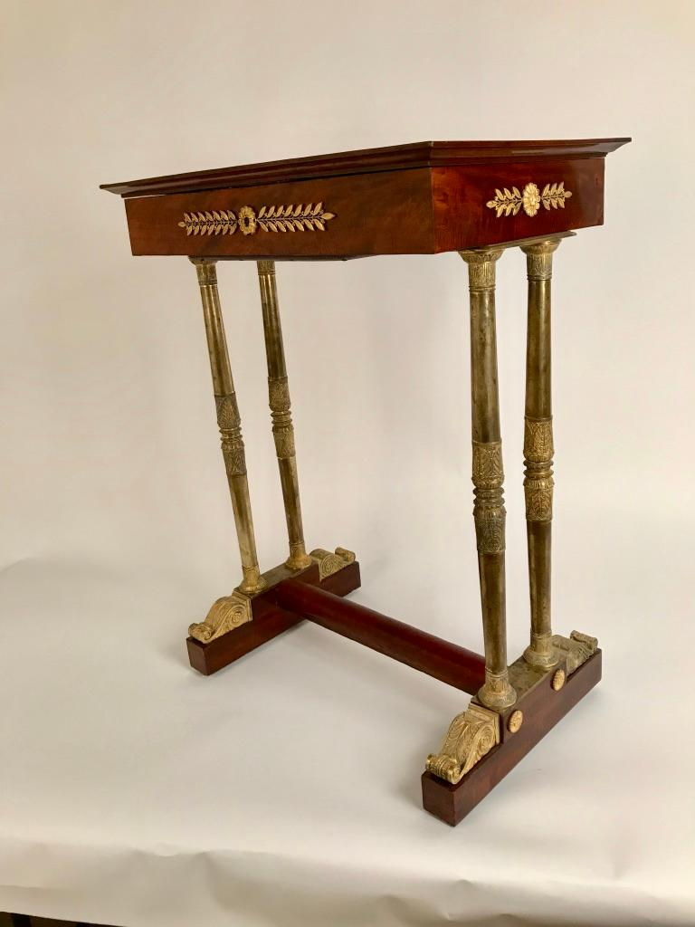A very fine Continental Regency period mahogany lift-top dressing table with high quality bronze dore legs and mounts. The columns with capitals decorated with palm leaves and papyrus flowers showing the Egyptian influence that became popular in the