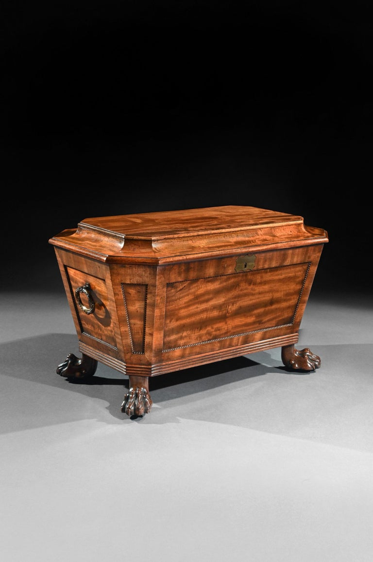 A very fine 19th century Regency mahogany wine cooler cellarette of sarcophagus form and wonderful natural color.  English, circa 1820  Having obtained a wonderful natural color, the whole of sarcophagus form with a cavetto moulded hinged top