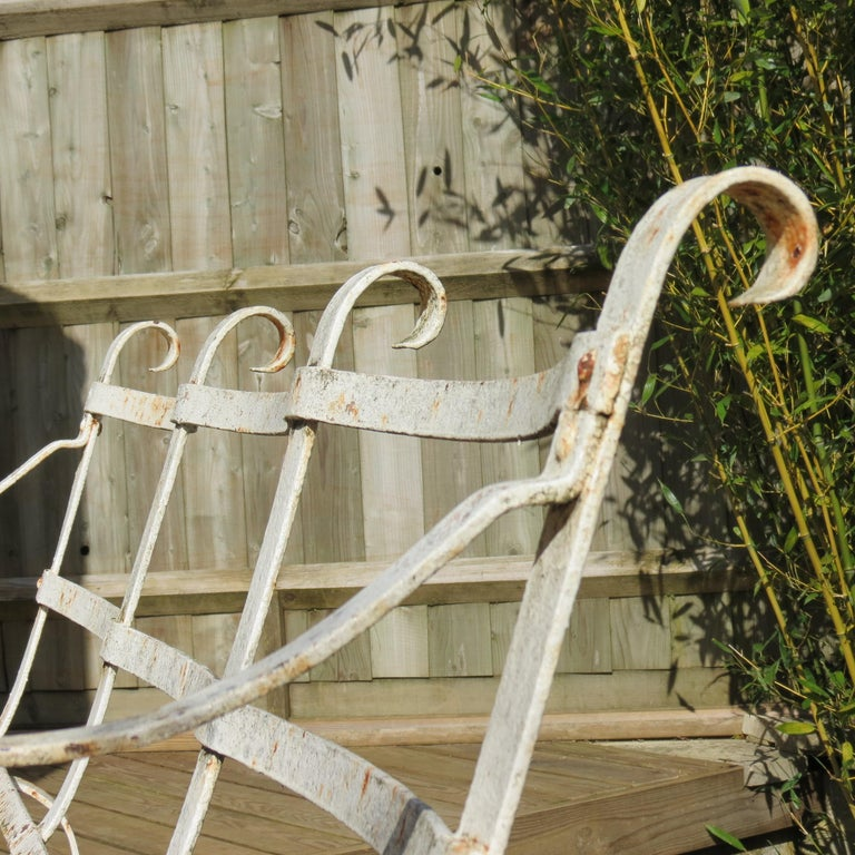 An original Regency garden bench from the 1820s. Wonderful shape, in good stable condition with beautiful patination all over. Made from very good quality flat steel bar and has several layers of paint, which are now heavily patinated adding to the