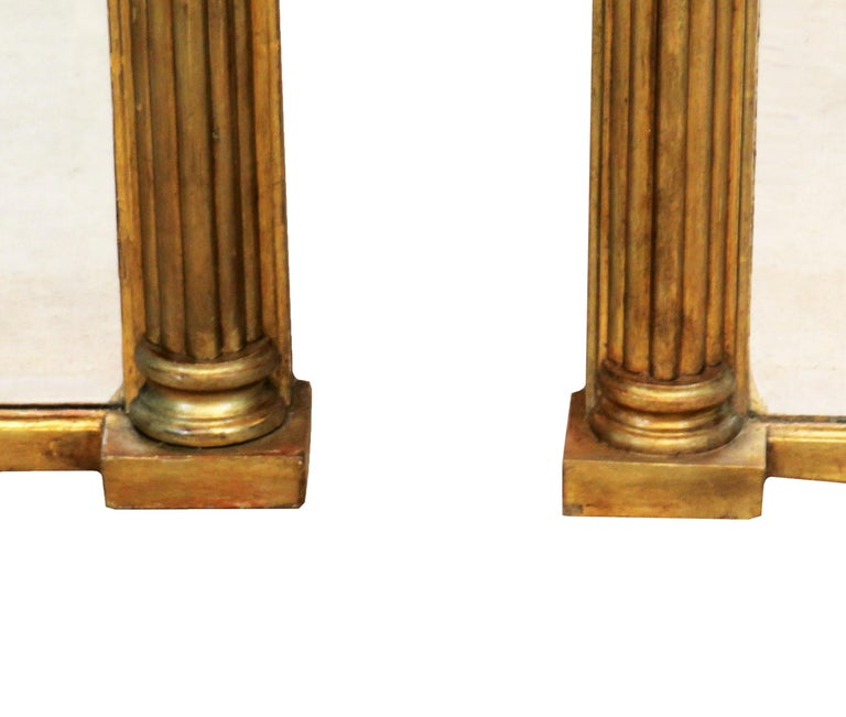 A very attractive and rarely found pair of Regency period giltwood and gesso overmantle mirrors having Roman scenes to top panel over triple split bevelled mirror plates flanked by elegant carved columns  (A good example in terms of design for