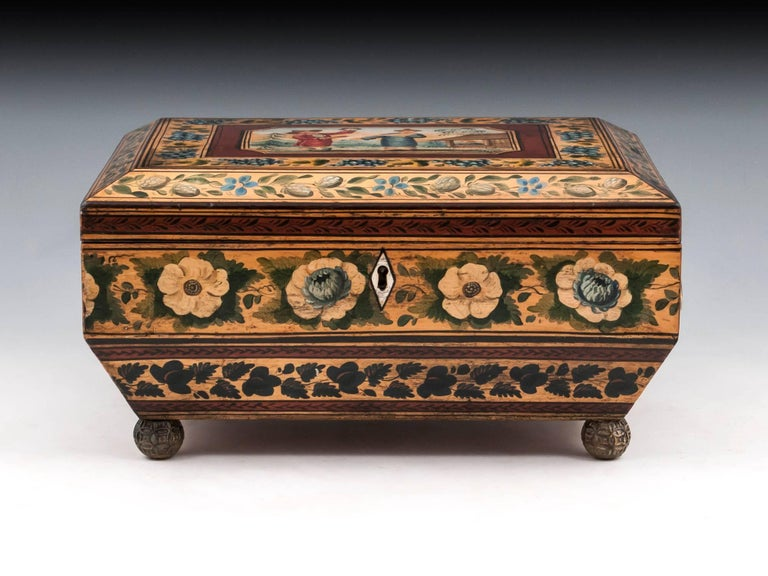 Exquisite penwork chinoiserie sewing box in sycamore, the top decorated with vibrant painted Chinese figures within a pretty grapevine border. The vibrant colours continue on all sides with more fruit and flowers. Lifting the lid of this penwork