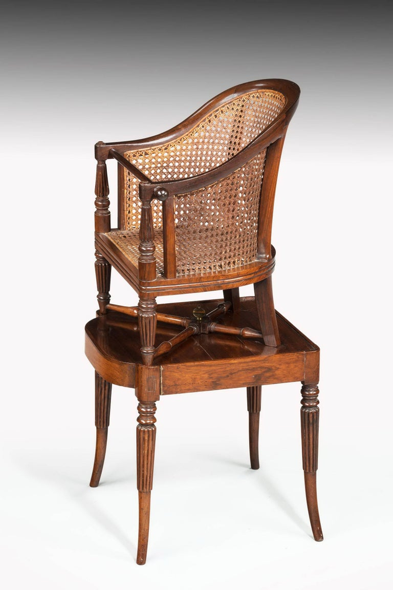 A very good example of a Regency period child's chair on stand. Minor damage to the cane work. Very best quality with beautifully reeded uprights. Original condition.   Measure: Seat height-23 inches.
