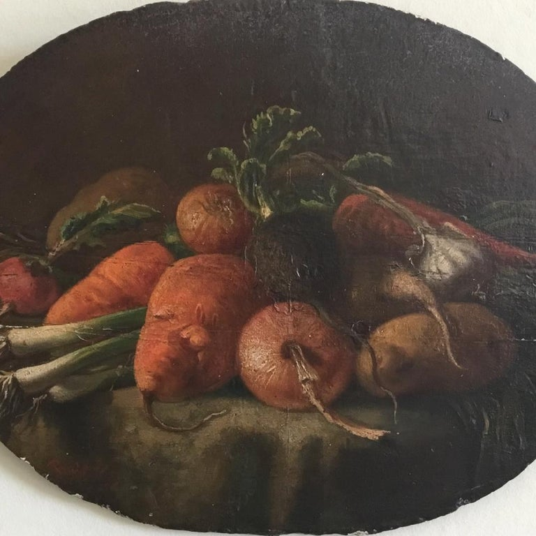 An early 19th century, oil on oval panel, still life study of vegetables. Indistinctly signed. A superb still life painting with wonderful detail and the most beautiful rich color palette. In generally good condition with a structural support to