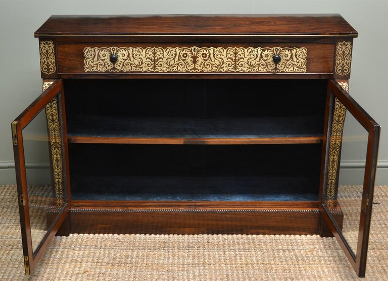 Spectacular Regency rosewood brass inlaid antique secretaire cabinet  Constructed from the finest quality figured rosewood, this spectacular secretaire cabinet has the most sensational brass inlays that could only be the work of a true craftsman