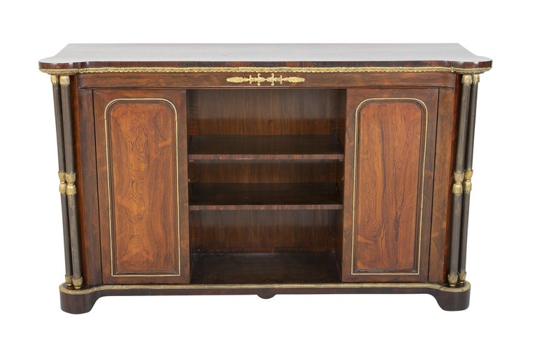 A fine English Regency rosewood bronze-mounted credenza with rare steel double column supports.