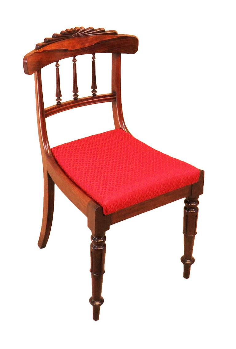 A very fine quality set of six regency period rosewood. Dining chairs having superbly figured top rail with carved. Fan decoration over elegant reverse tapering turned and fluted spindles and bowed drop in seats raised on elegant. Turned