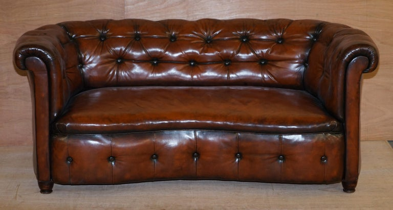 We are delighted to offer for sale this stunning fully restored Regency circa 1810-1820 hand dyed cigar brown leather serpentine fronted Chesterfield club sofa  This sofa is as rare as they come, it's a period original Regency which is rare in its