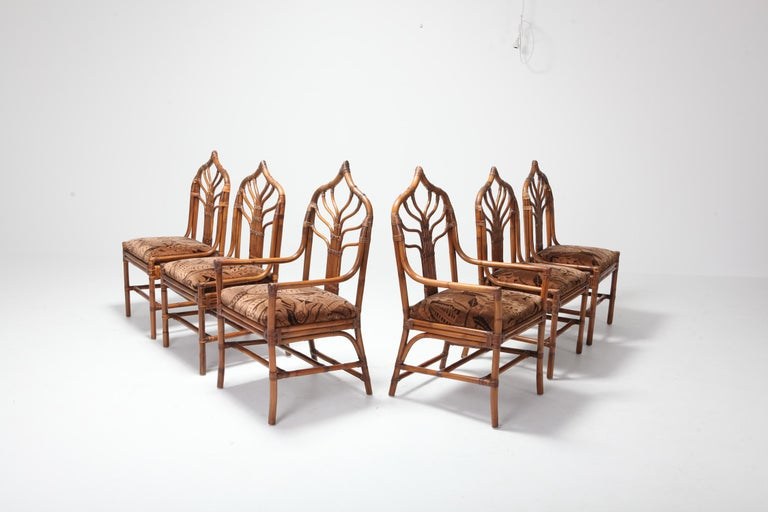Sculptural Italian bamboo dining chairs with floral original upholstery.  A set of 6 with 4 chairs and 2 armchairs.    Italy, 1960s.