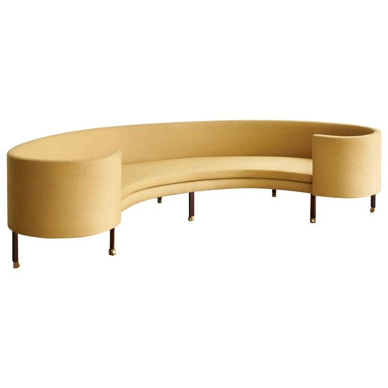 Regency sofa in yellow linen, walnut and brass