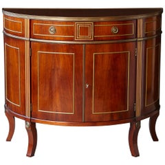 Regency Style Demilune Commode with Brass Moldings