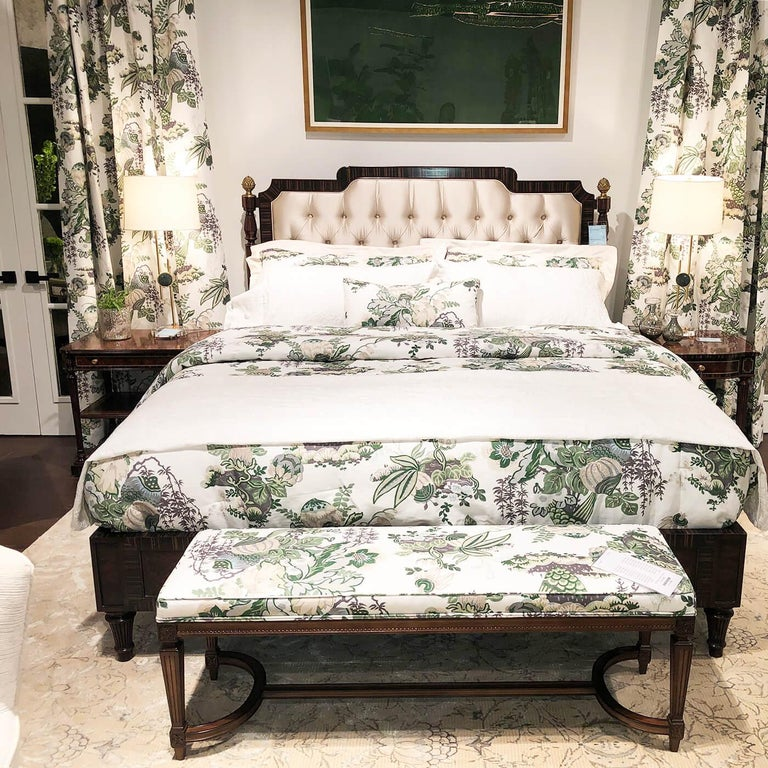 A fine Regency style walnut burl bed with ebonized banding and a matching pair of Regency style inlaid one drawer nightstands.
