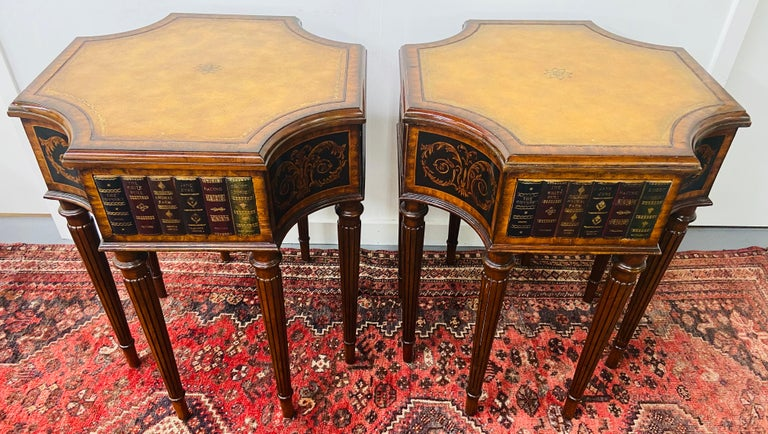 This timeless pair of Maitland Smith mahogany and leather library book tables in Regency style features an ingenious pattern. Each octagonal shaped table has four drawers with leather books front and a gold leather tooled top and eight columnar